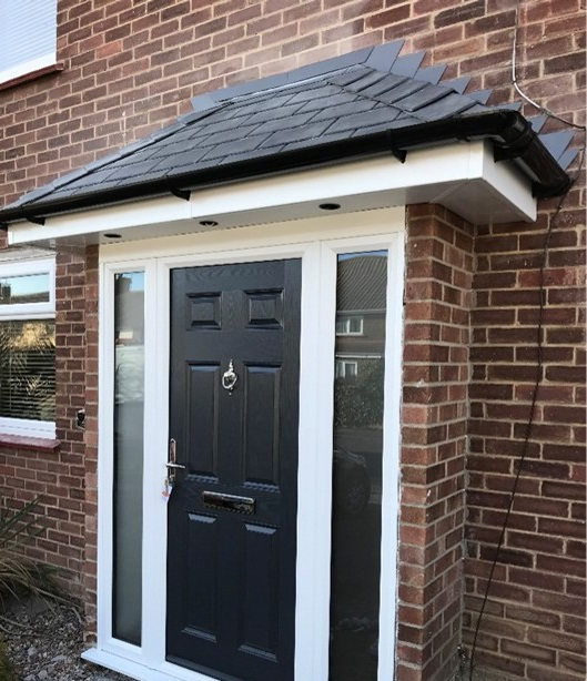 Porch with black front door
