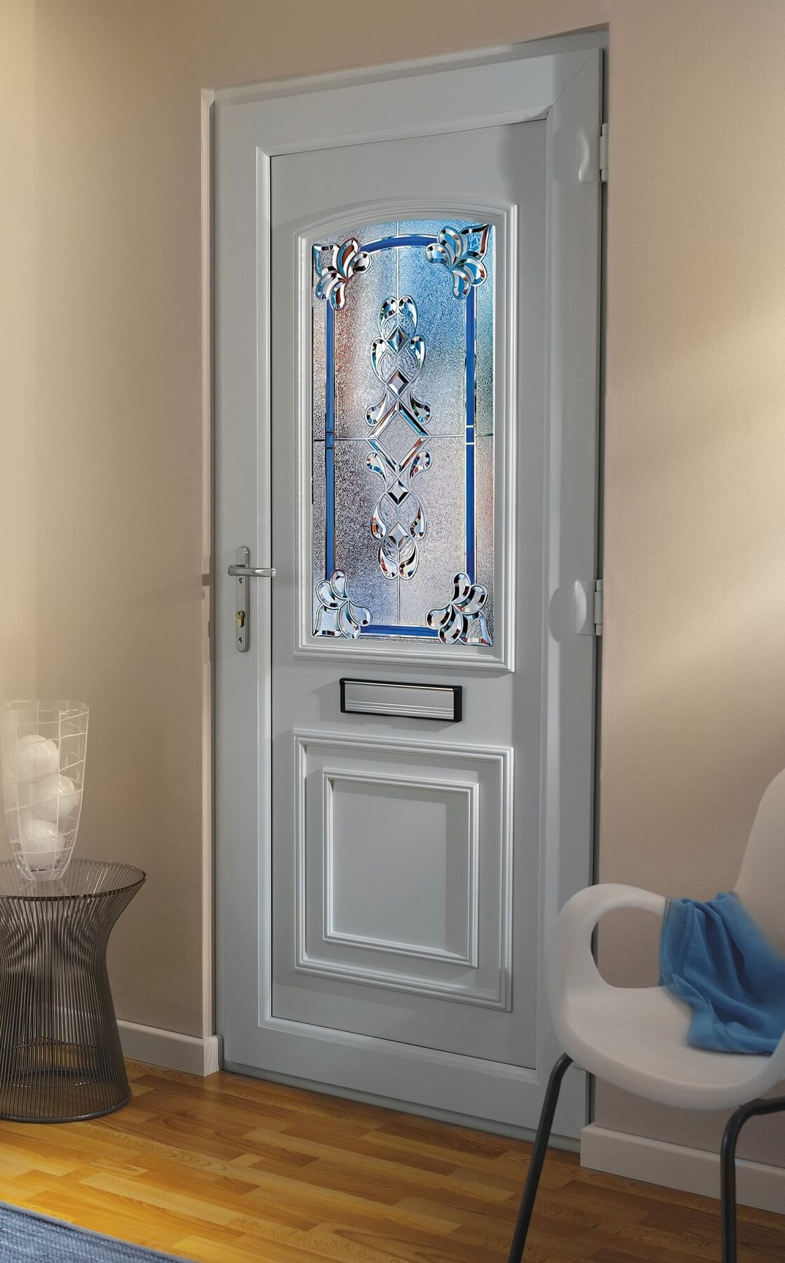 White uPVC front door with chrome furniture