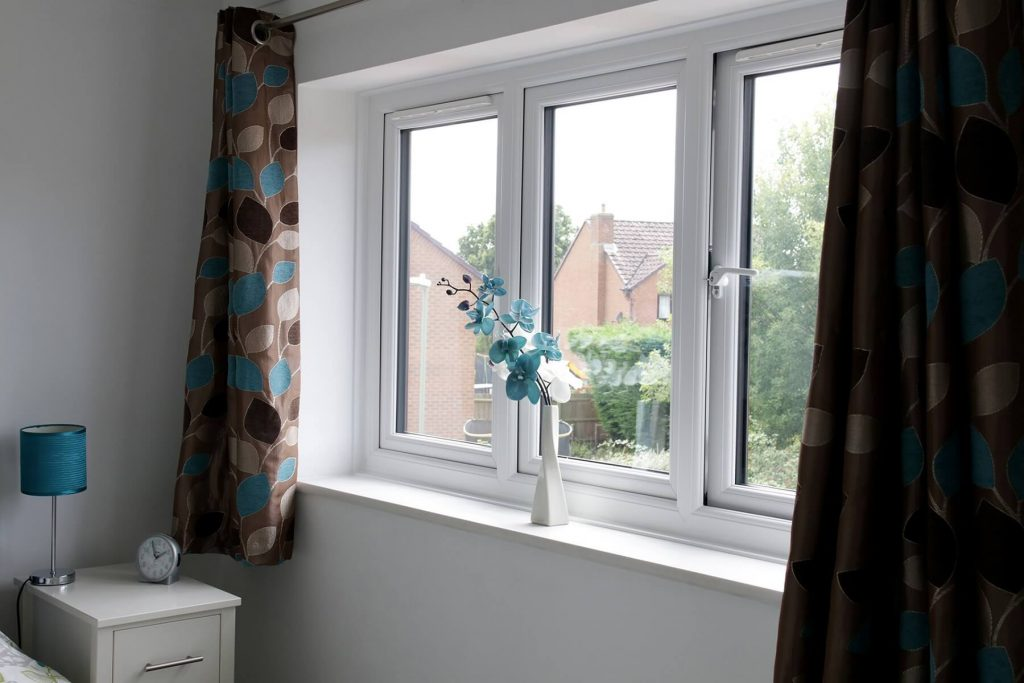 Interior view of white casement windows