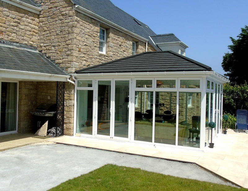 Grey Supalite roof conservatory with Extralight tiles