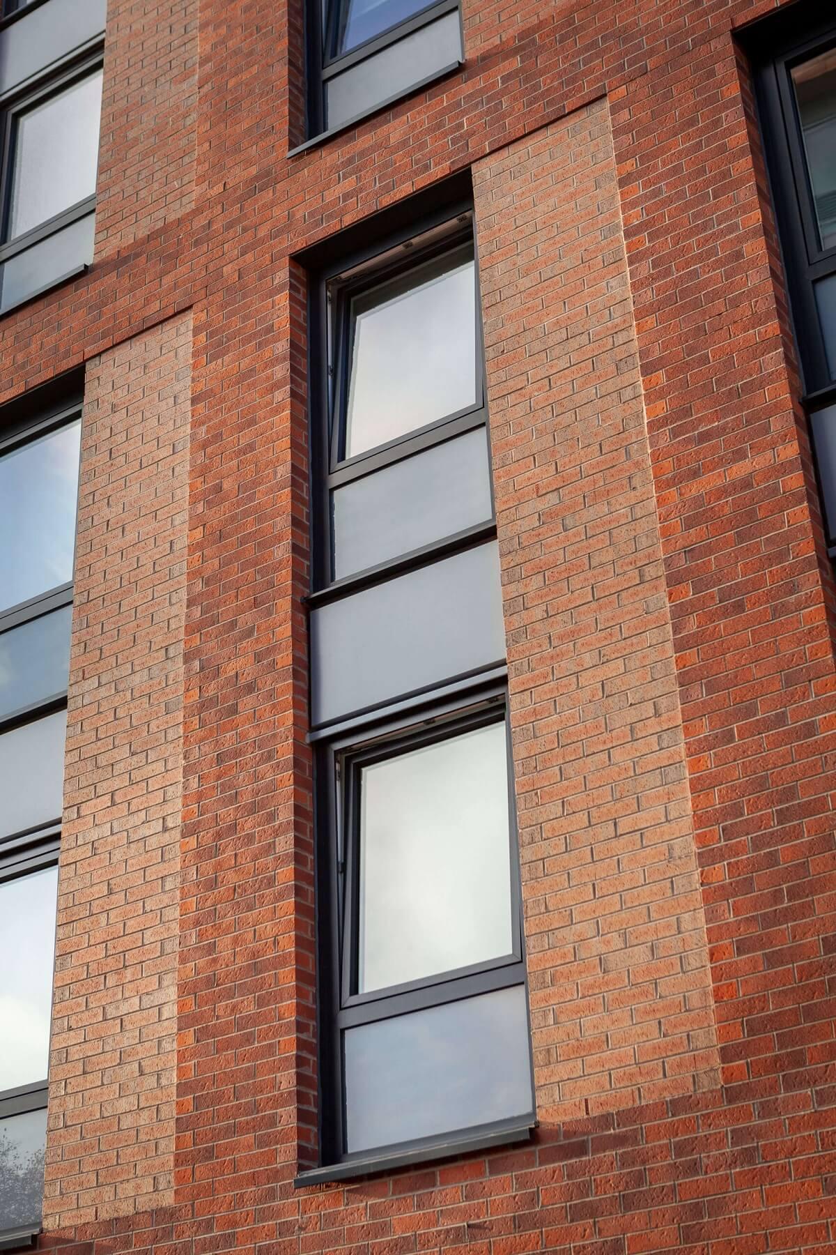 Tilt and turn windows on a block of flats