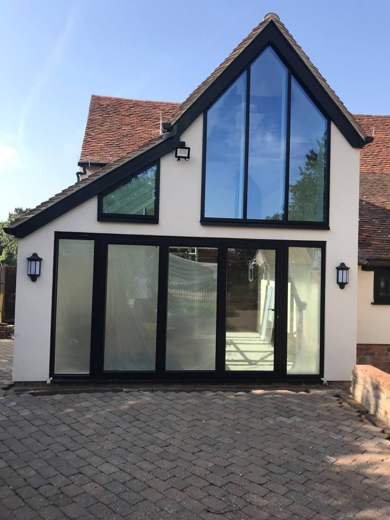 Black bifold doors with large gable windows
