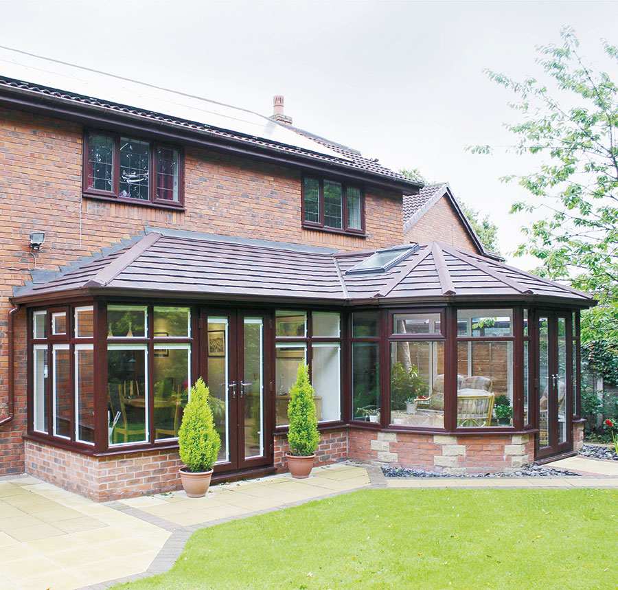 Brown tiled roof conservatory with trees
