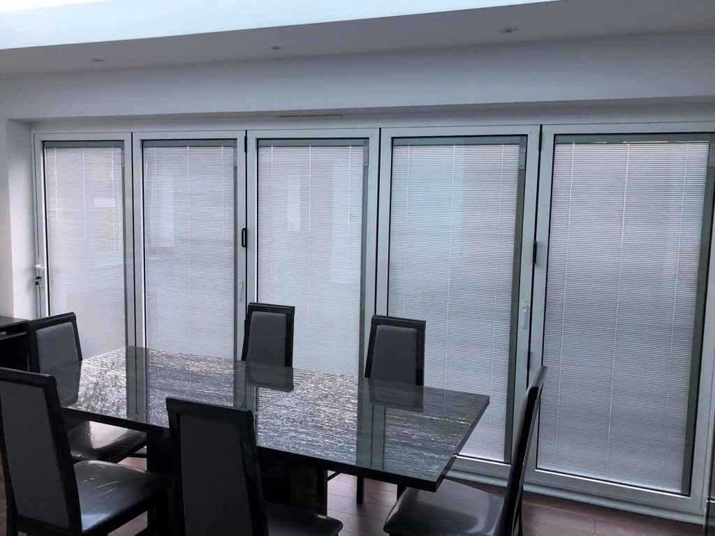 White bifold doors with integral blinds