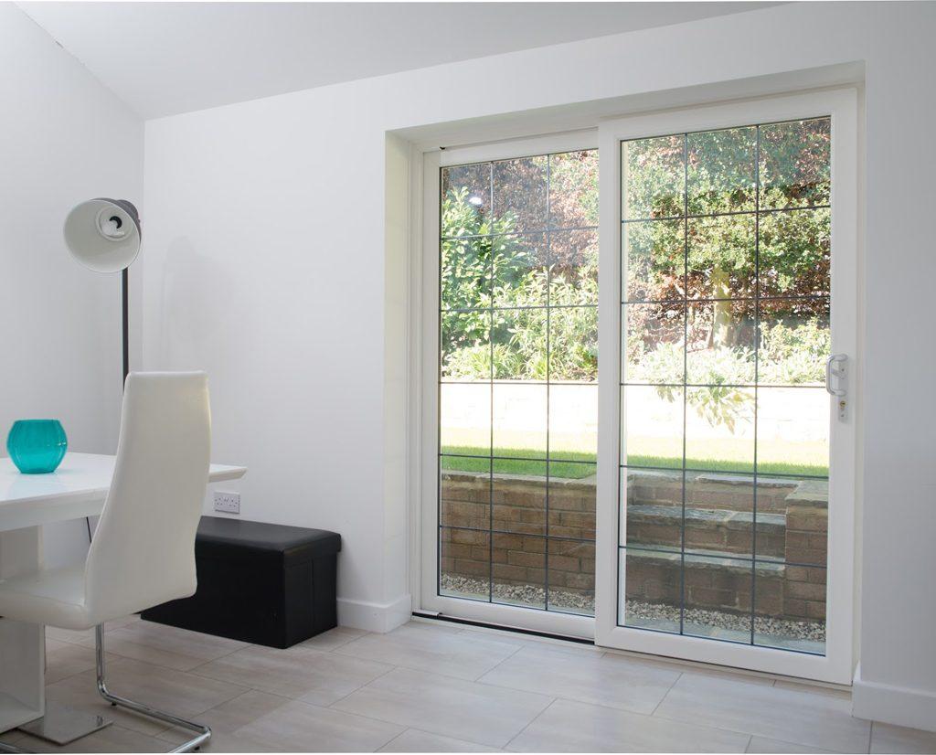 White uPVC sliding doors with leaded glass